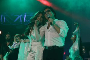 Latoya Jackson sings in Farsi with Iranian singer Andy at a concert in Los Angeles.